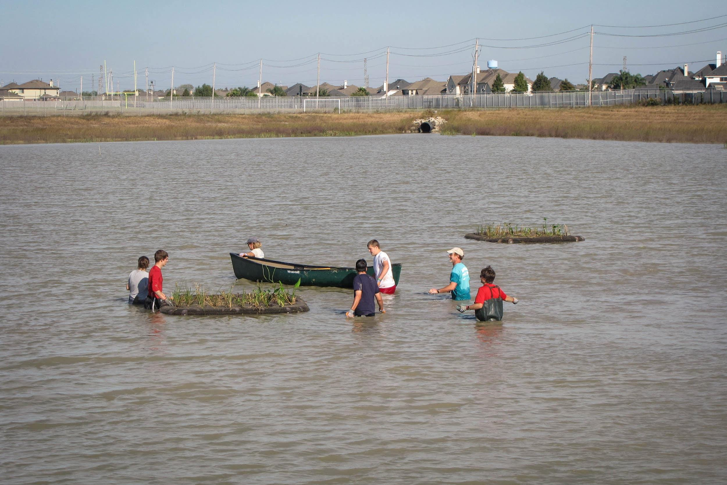 Installing the floating wetlands at CCISD Educational Village. Photo by H. Brown