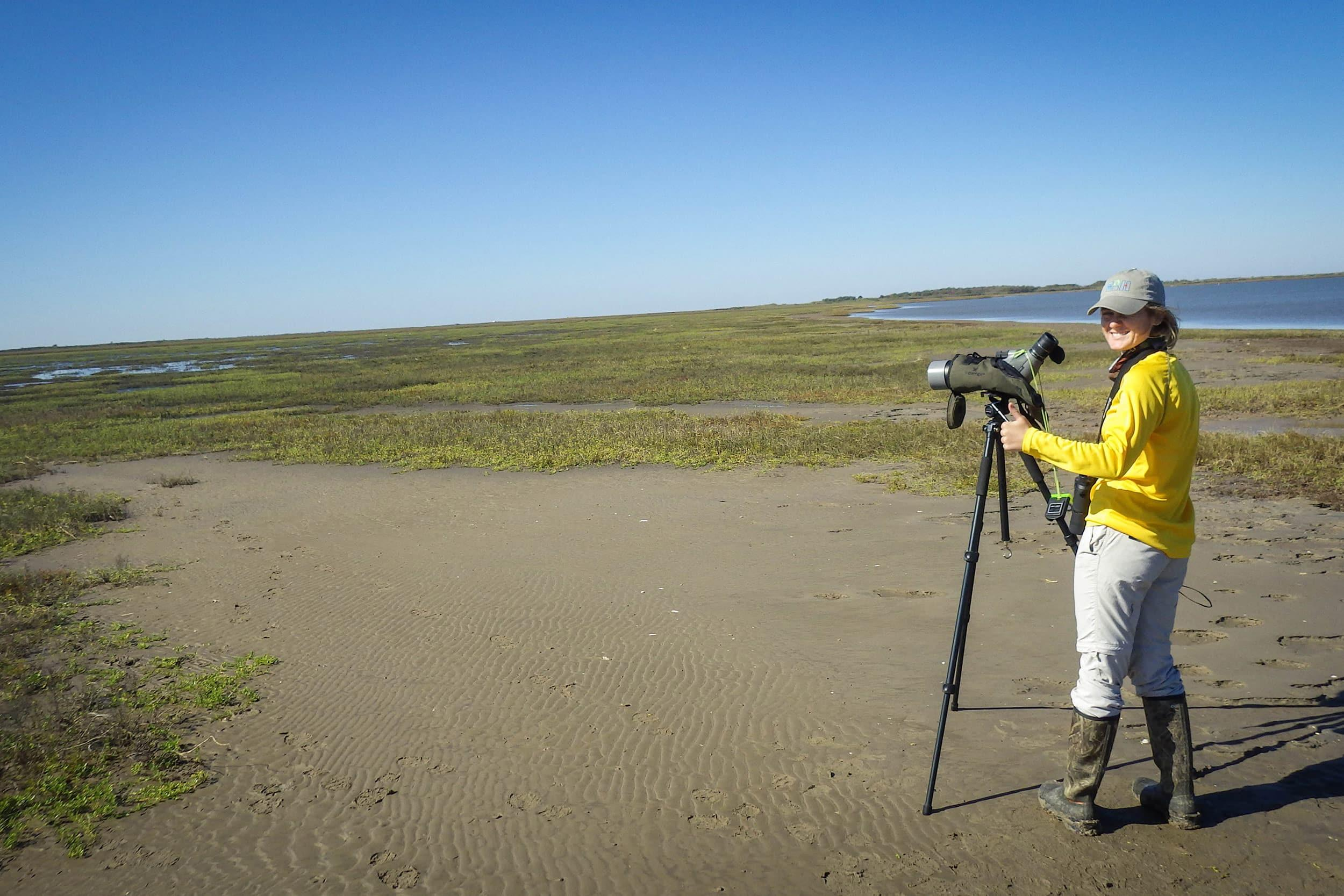 Anna Vallery, graduate assistant, conducts a bird survey as part of her research project