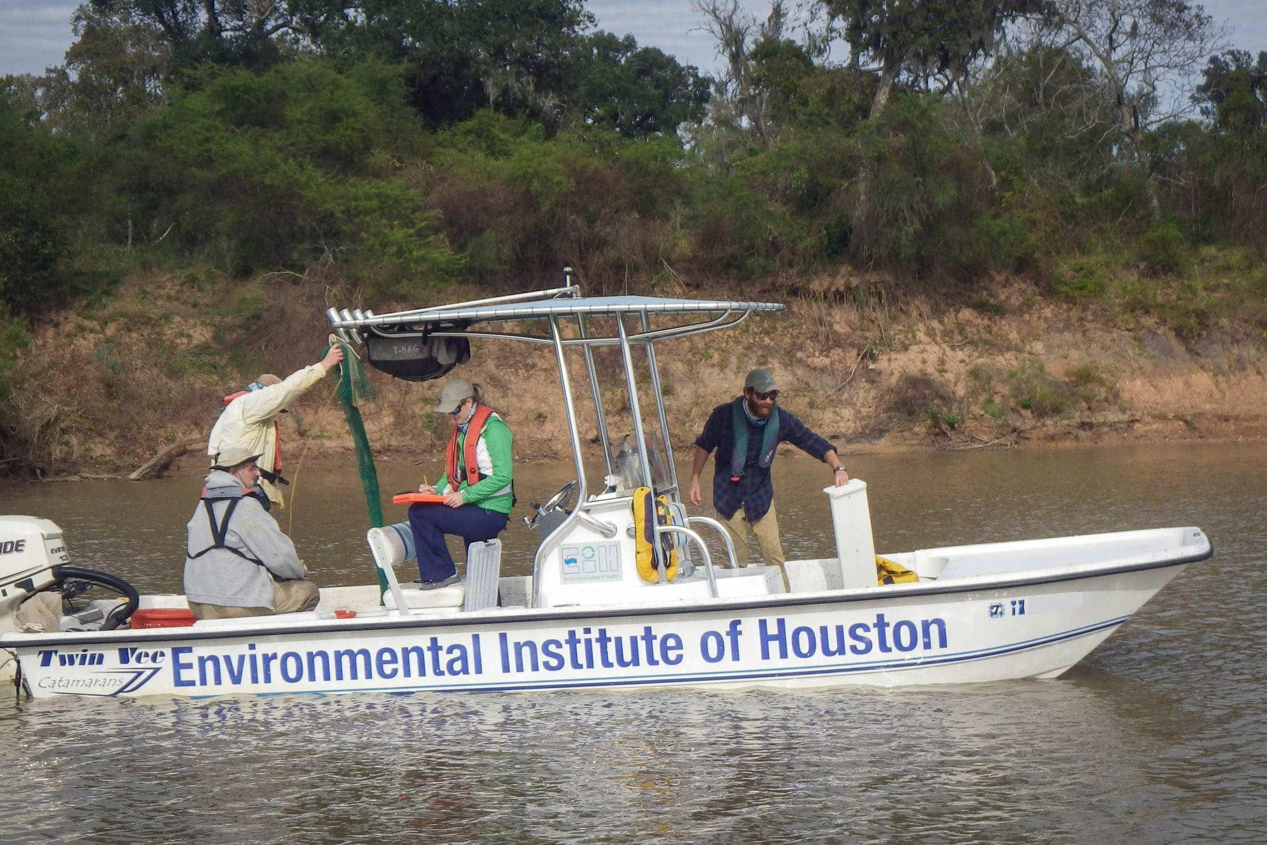 George Guillen, Tyler Swanson, Jenny Oakley, and Cory Scanes trawl the Lower Brazos River