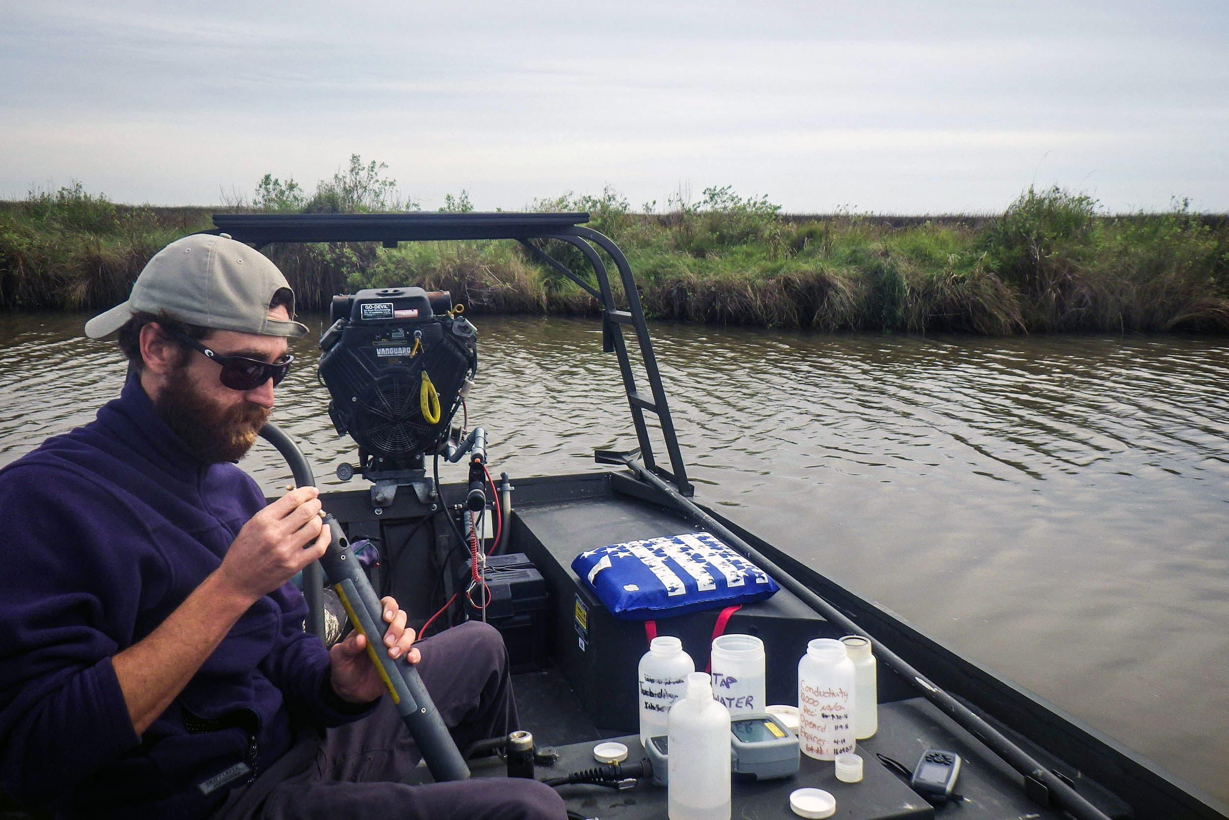 Cory Scanes, senior research associate, calibrates a sonde for deployment in Anahuac NWR