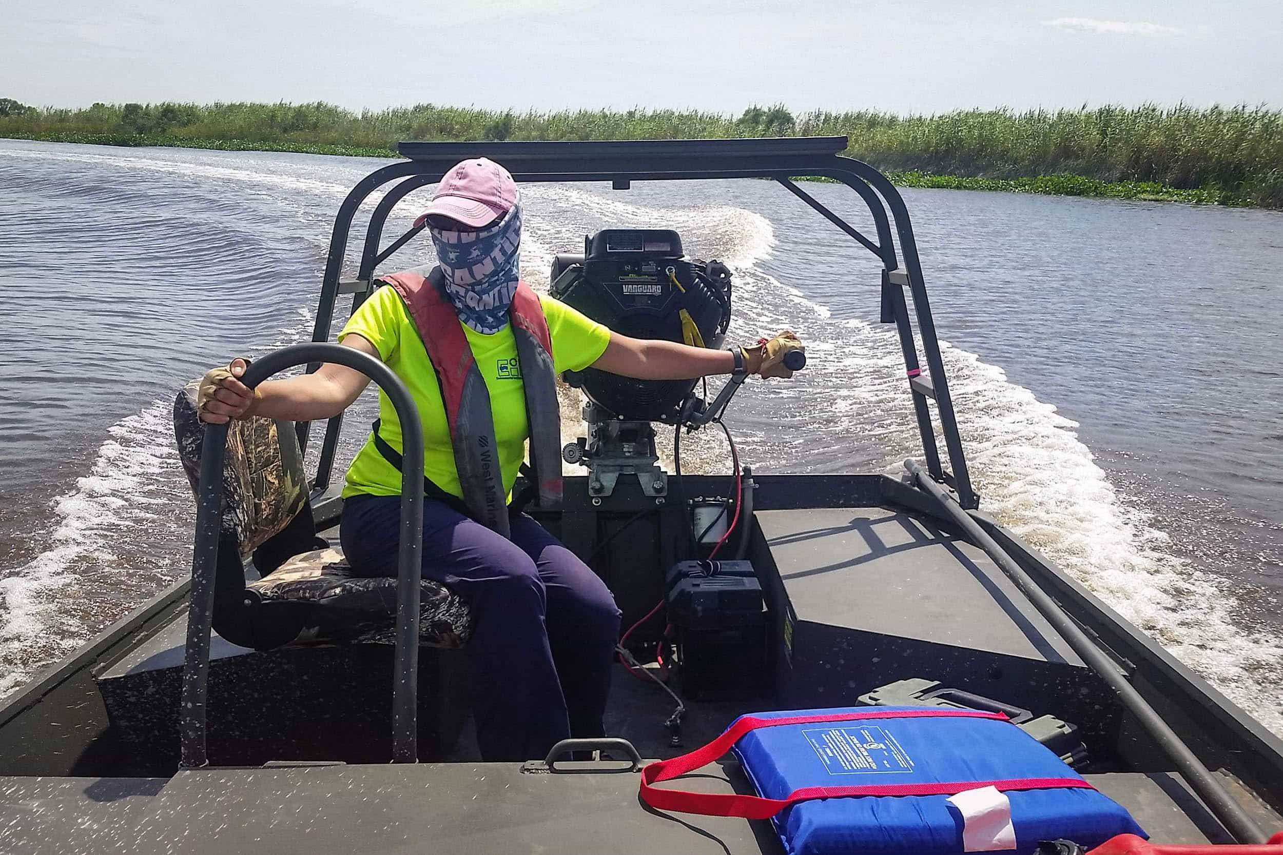 Sherah Loe, research assistant, steers EIH's Go-Devil to a monitoring site in Anahuac NWR