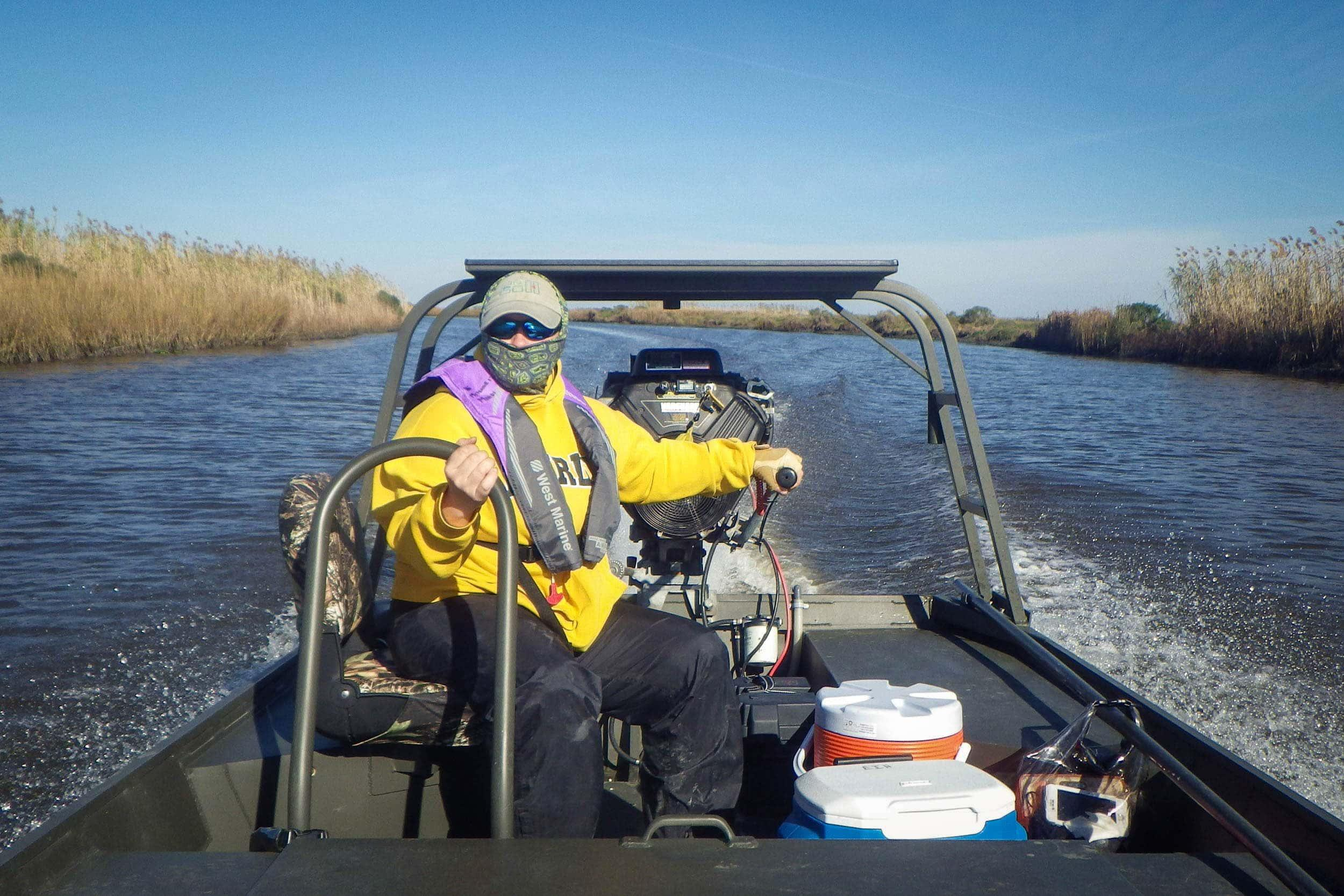 Mandi Gordon, senior biologist, steers the Go-Devil to a sampling site