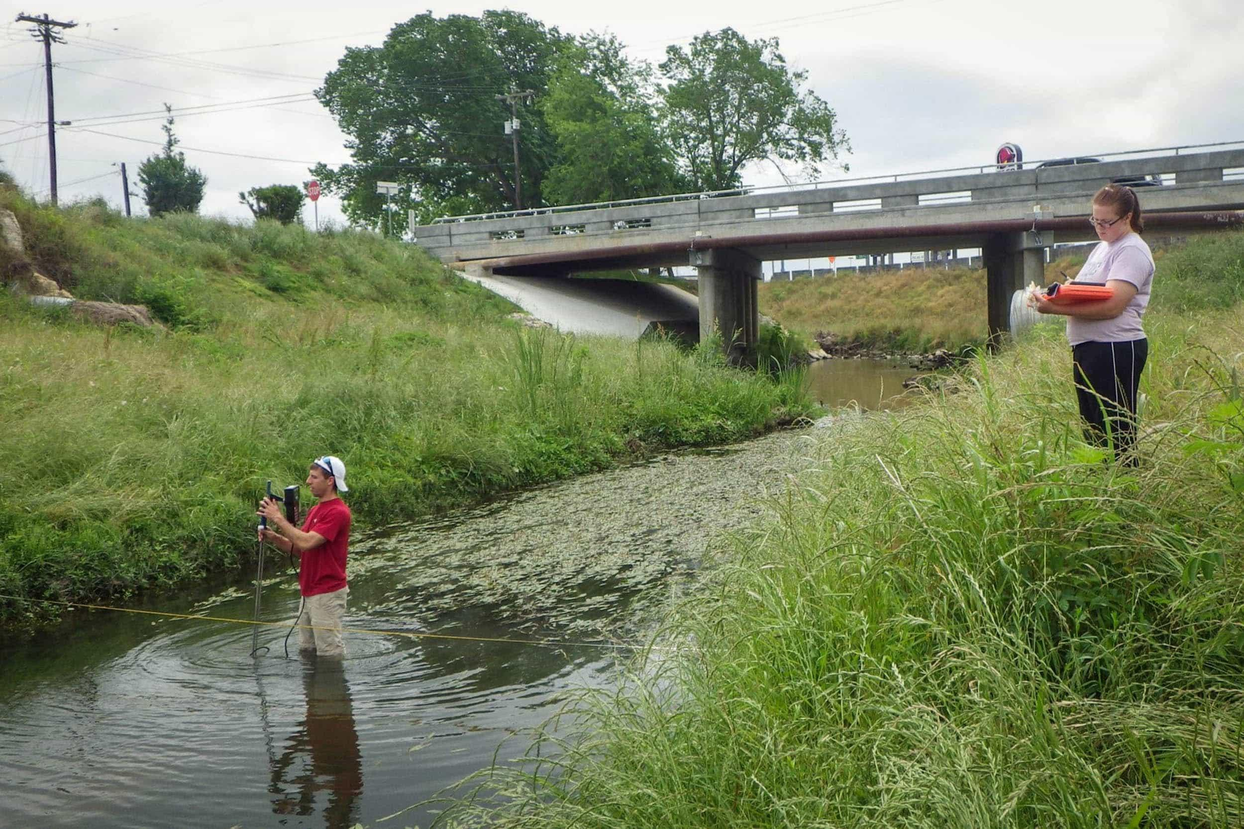 EIH scientists use the SonTek flow tracker to take flow measurements.