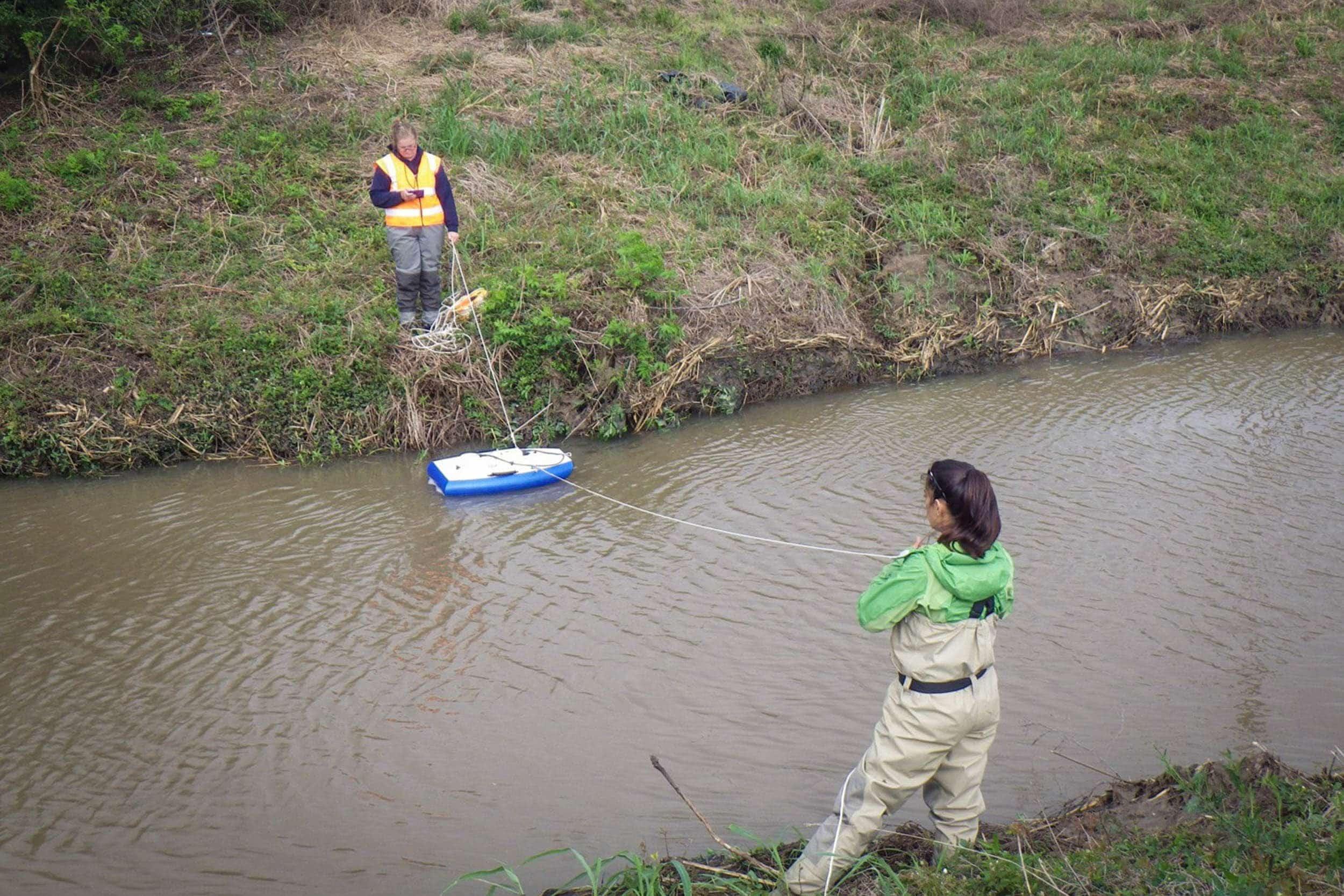 Natasha Zarnstorff and Kristi Fazioli use the SonTek flow boat to take flow measurements.