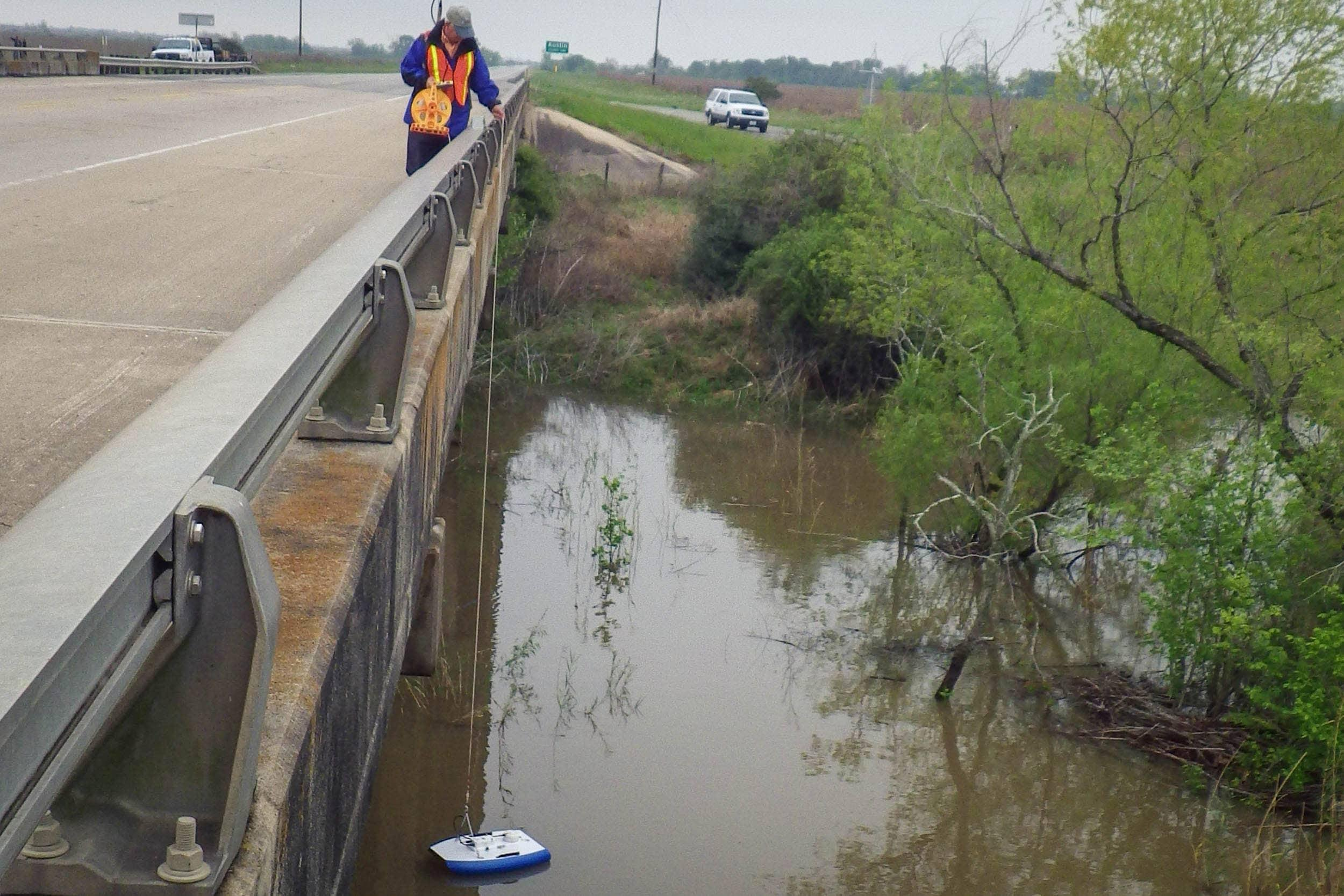James Yokley collects flow data with a SonTek flow boat.