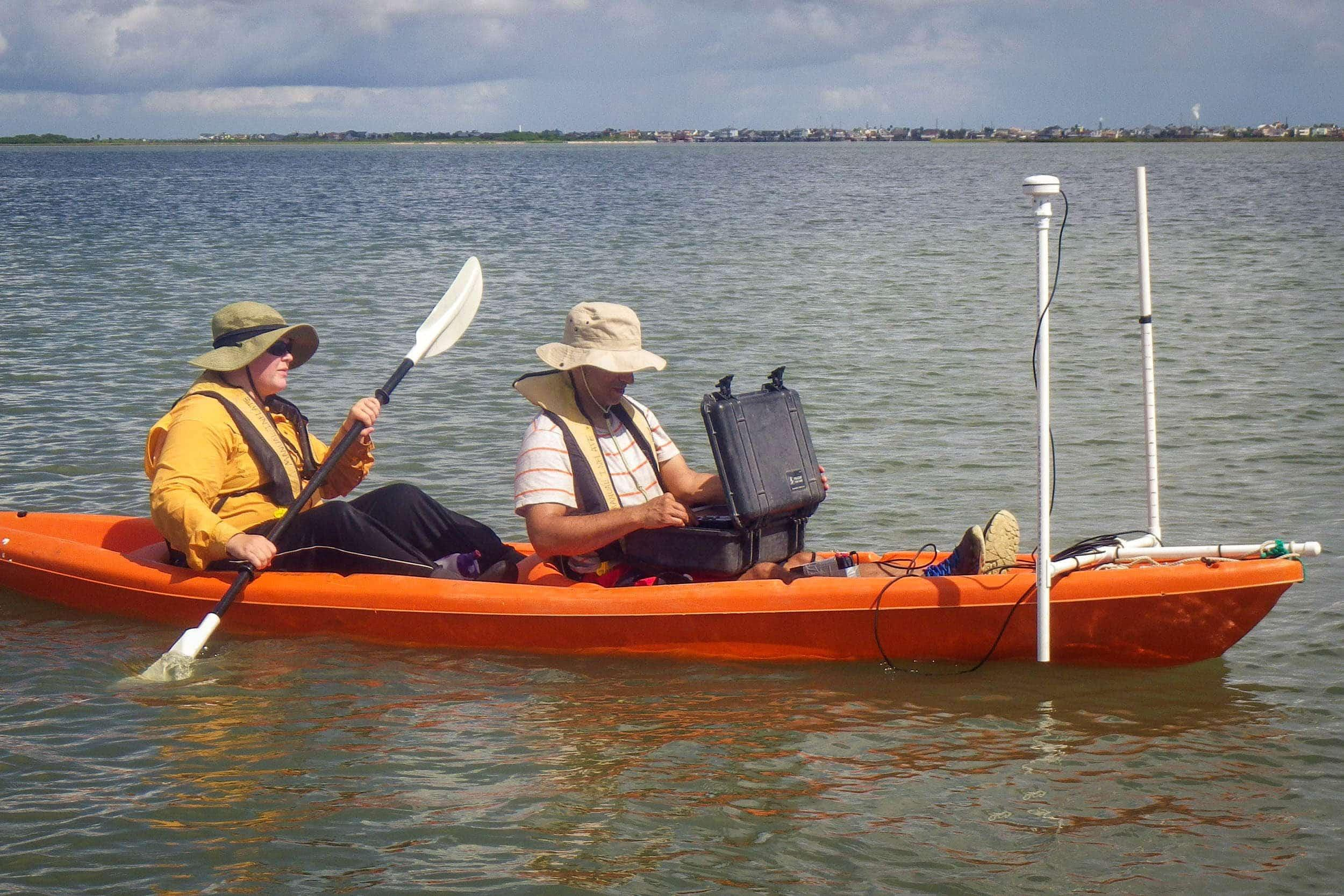 Natasha Zarnstorff, research assistant, and Marc Mokrech, senior research scientist, utilize the sidescan sonar to conduct an oyster reef survey in Galveston Bay.