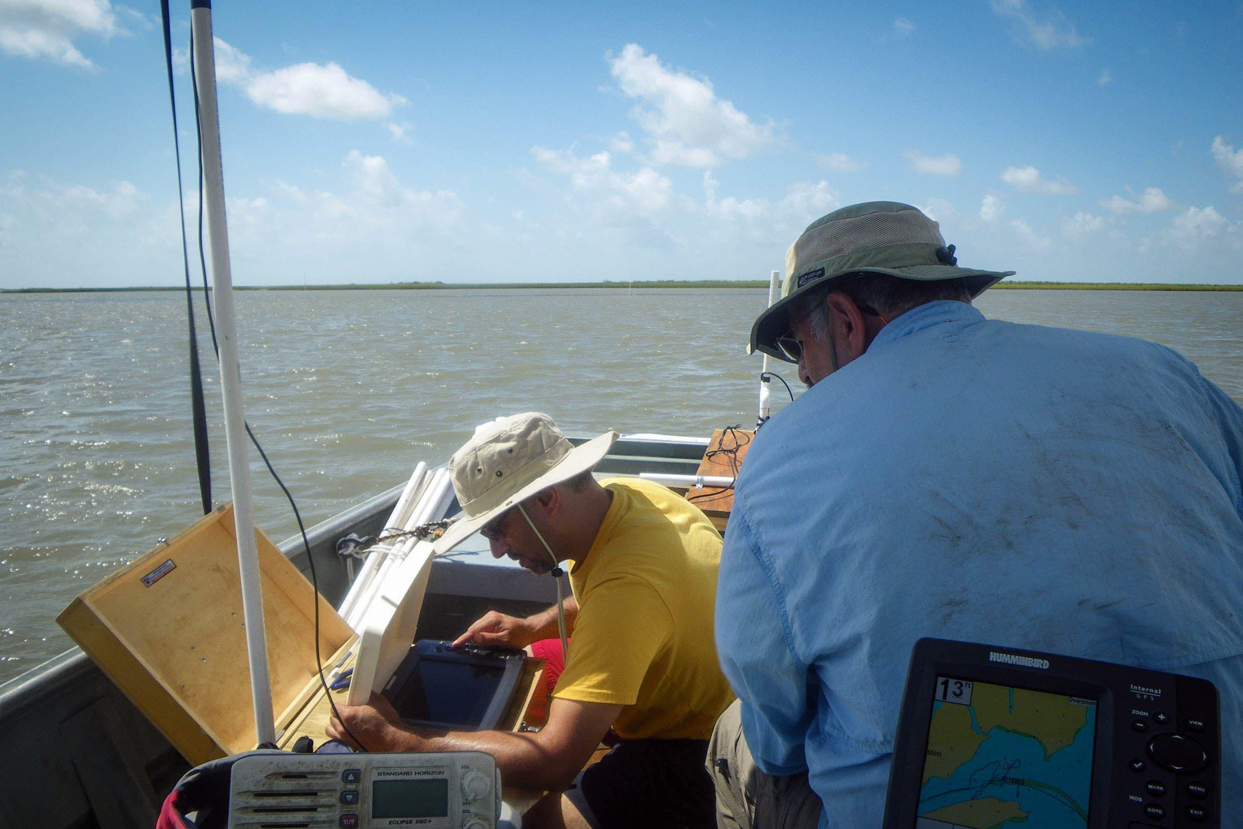 Marc Mokrech, senior research scientist, and George Guillen, executive director, utilize the sidescan sonar to locate oyster reefs in Galveston Bay.