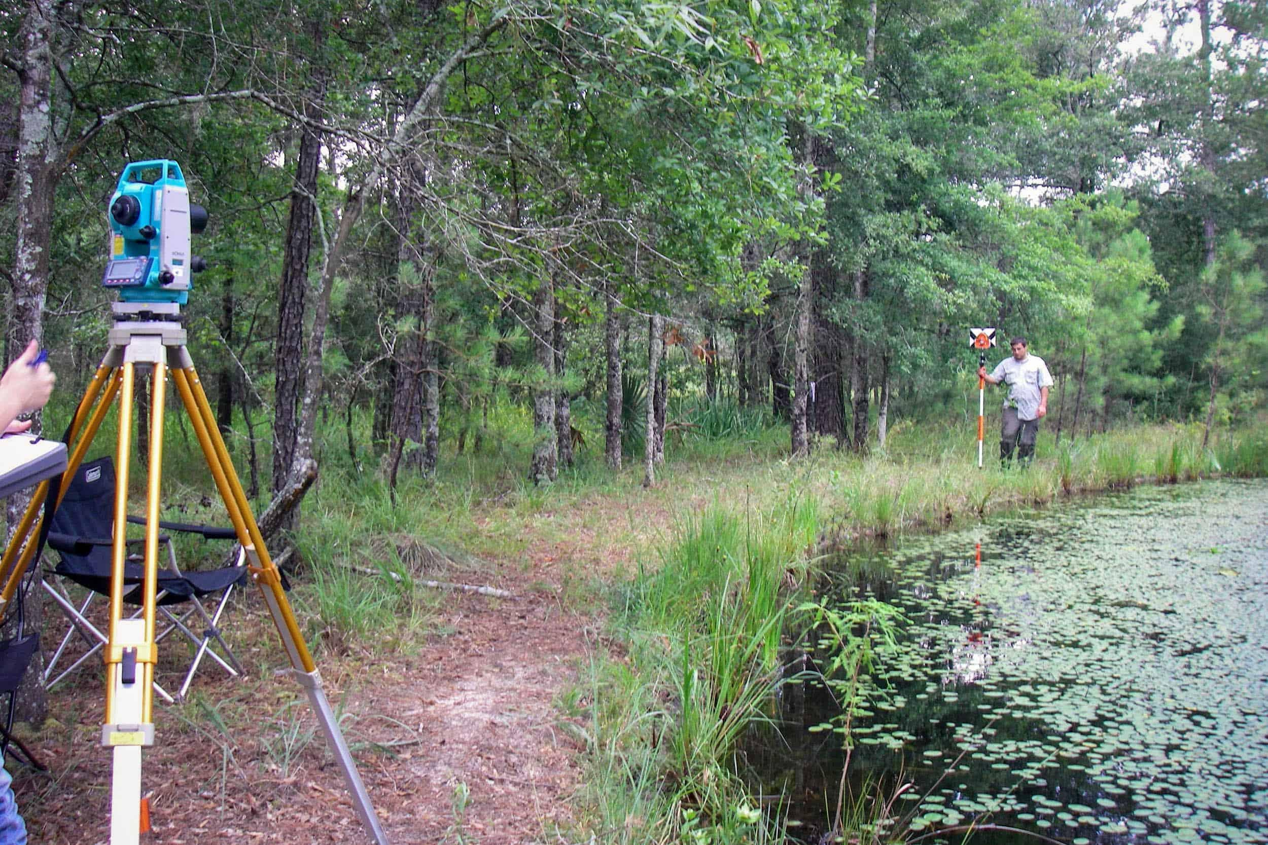 Taking Total Station Readings At Greens Bayou Wetland Mitigation Banks