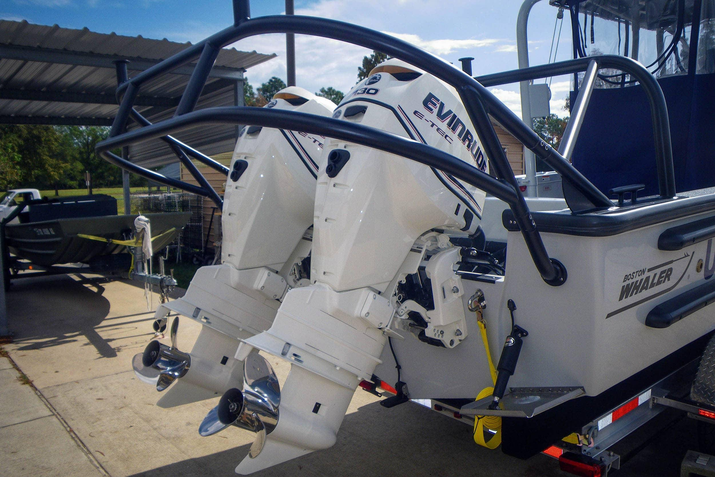 The Whaler is Equiped with Twin 130hp Evinrude Outboard Motors