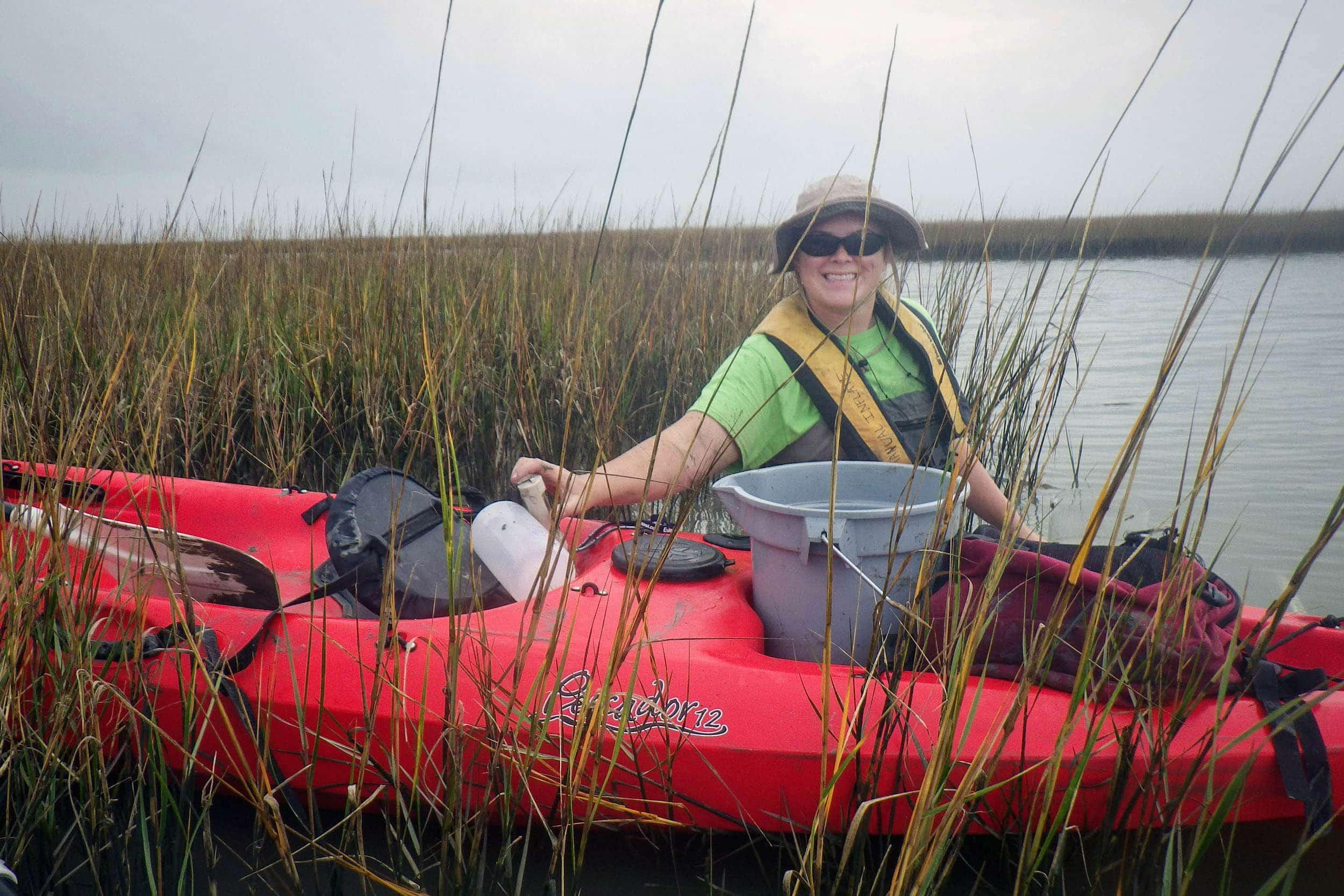Natasha Zarnstorff, research assistant, collects marsh water quality samples at Jumbile Cove, Galveston, Texas.