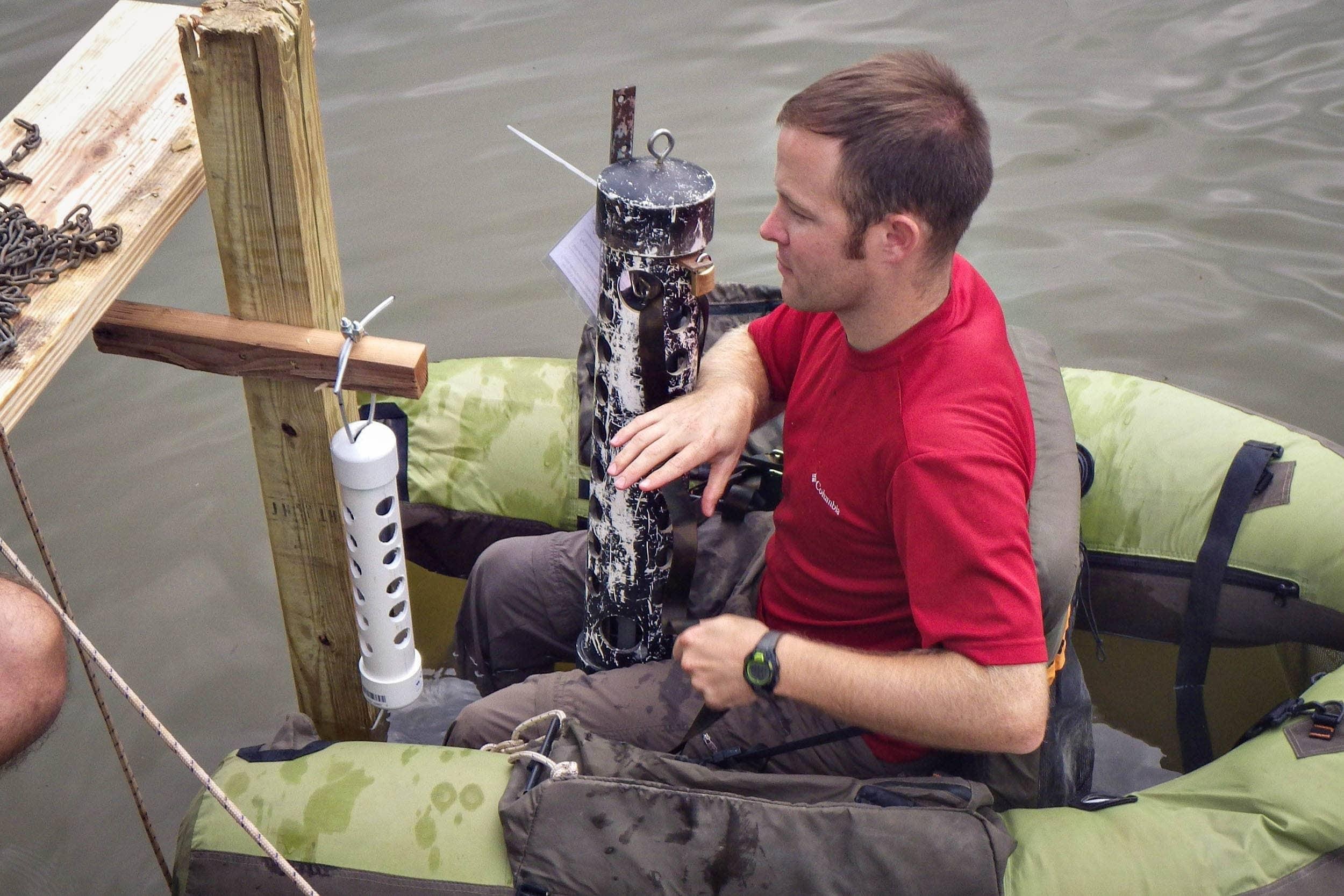 Stephen Curtis deploys water quality monitoring sondes