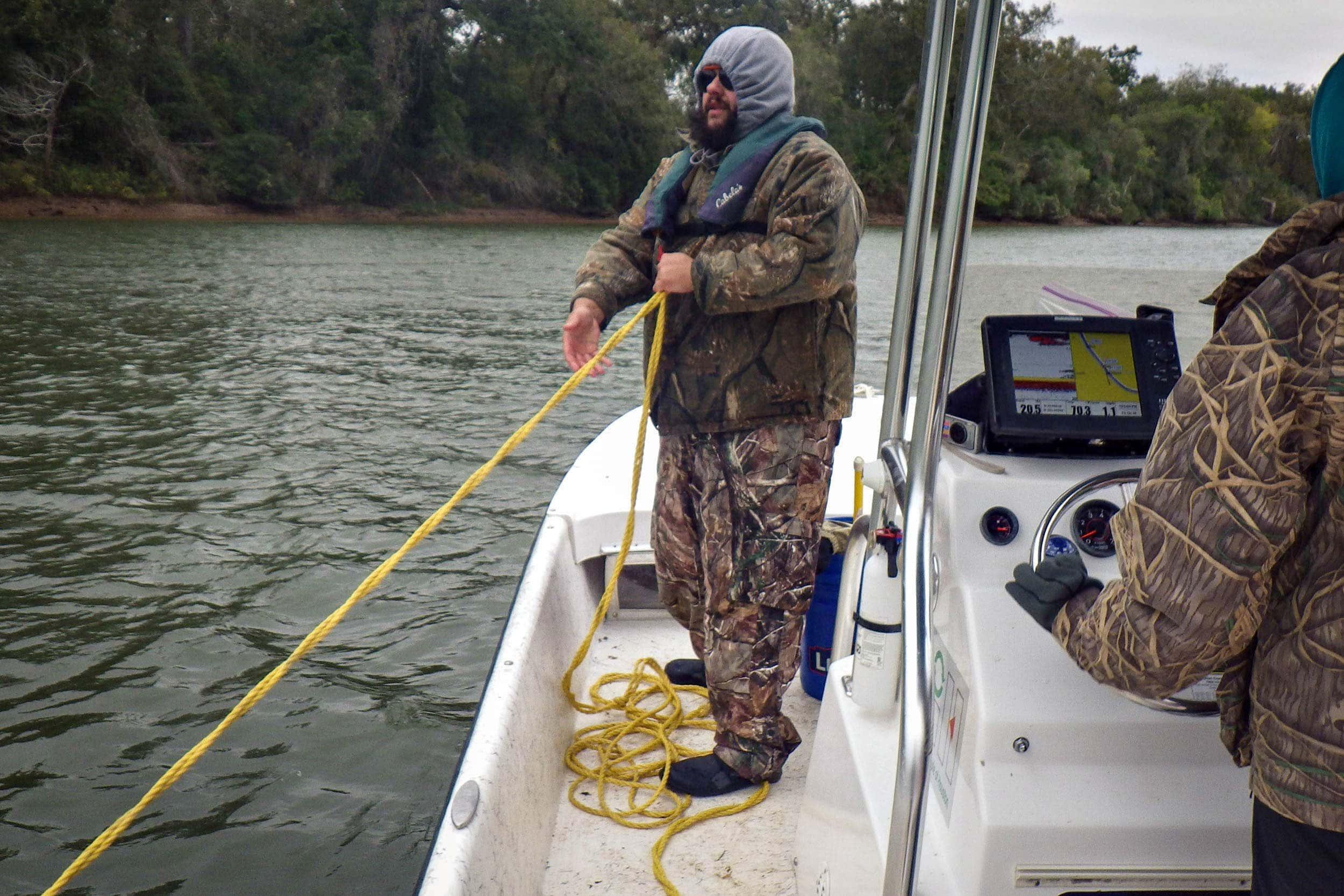 Bryan Alleman retrieves the otter trawl