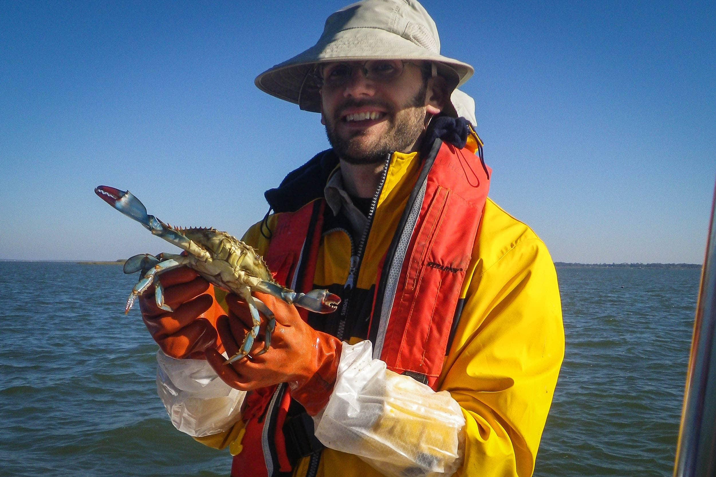 Richard Blackney, EIH research assistant, with a blue crab captured in deep water trap deployment
