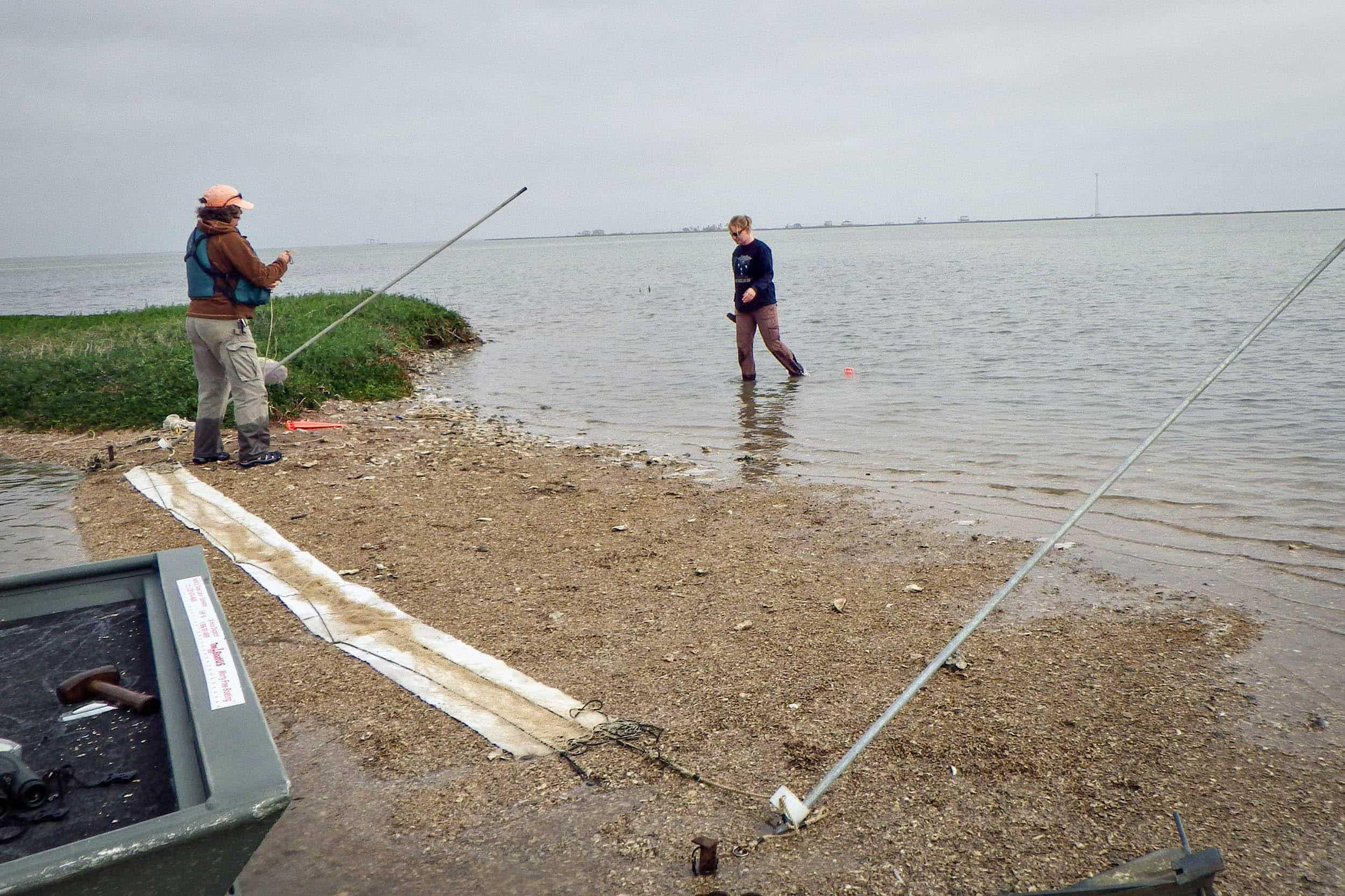 Susan Heath, GCBO avian conservation biologist, and Amanda Anderson, EIH research assistant, set up a whoosh net
