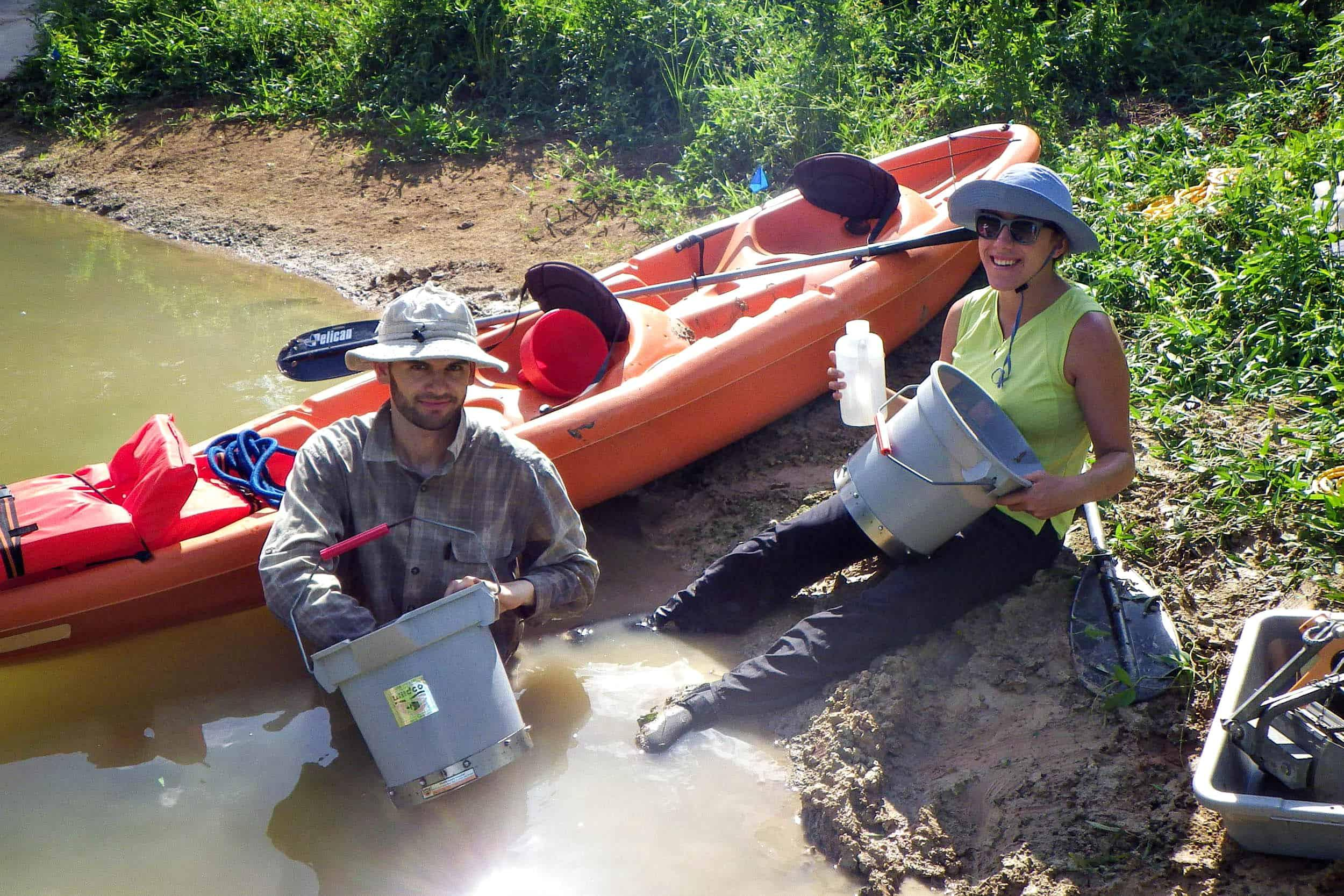 Research assistants Richard Blackney and Laila Melendez rinse benthic grab samples.