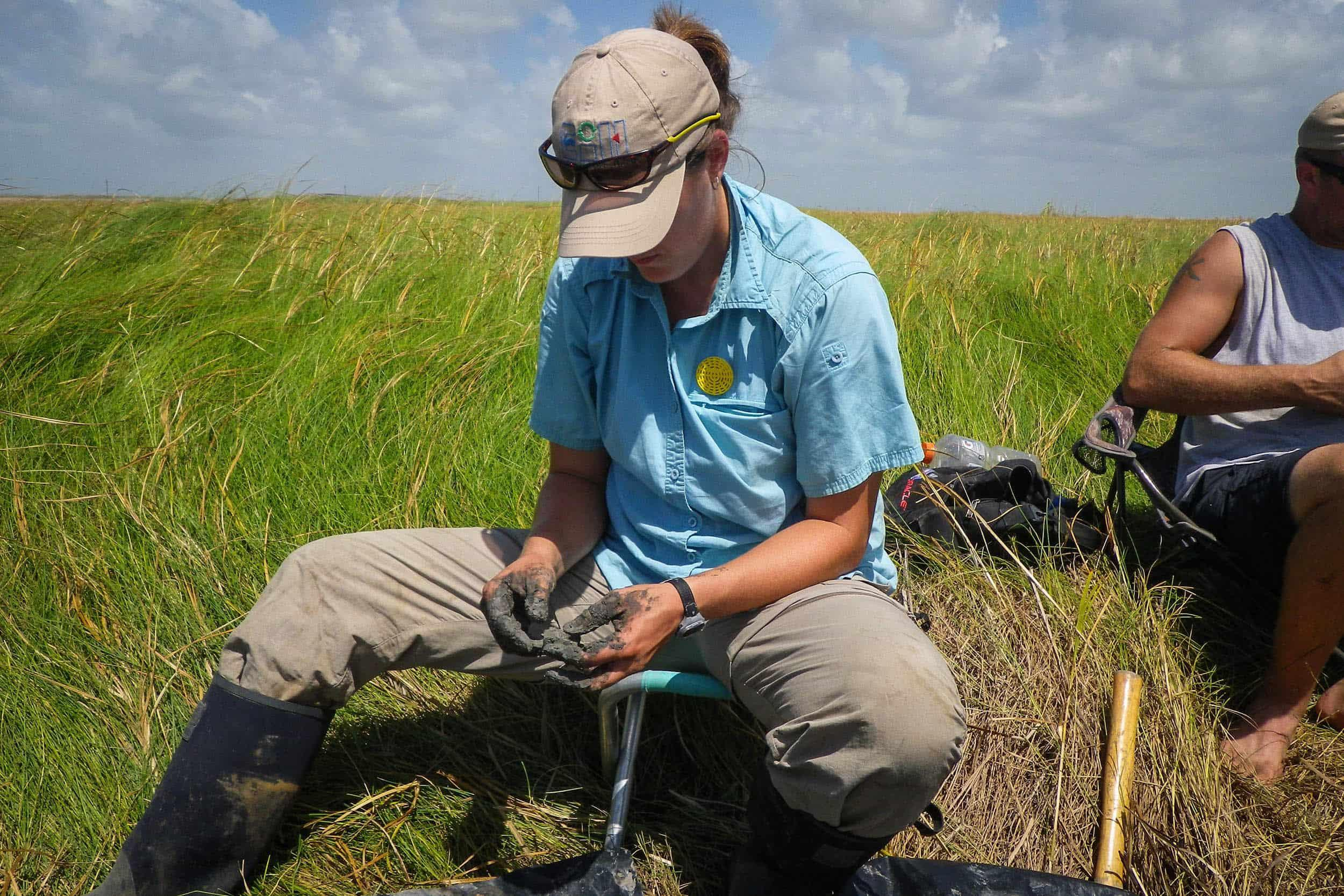 Misty Shepard, research associate, characterizes a soil sample at the McFaddin National Wildlife Refuge