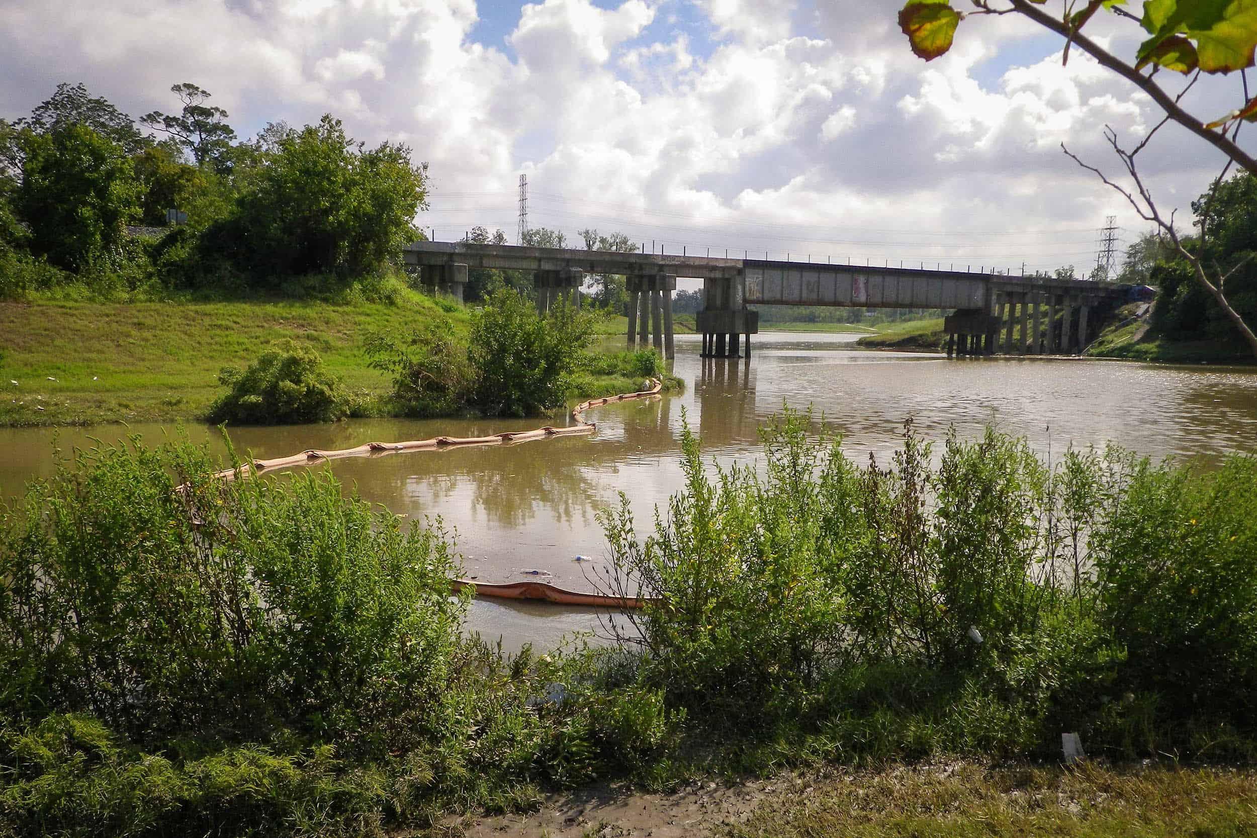 Trash boom/float at pond 3 outlet to Brays Bayou