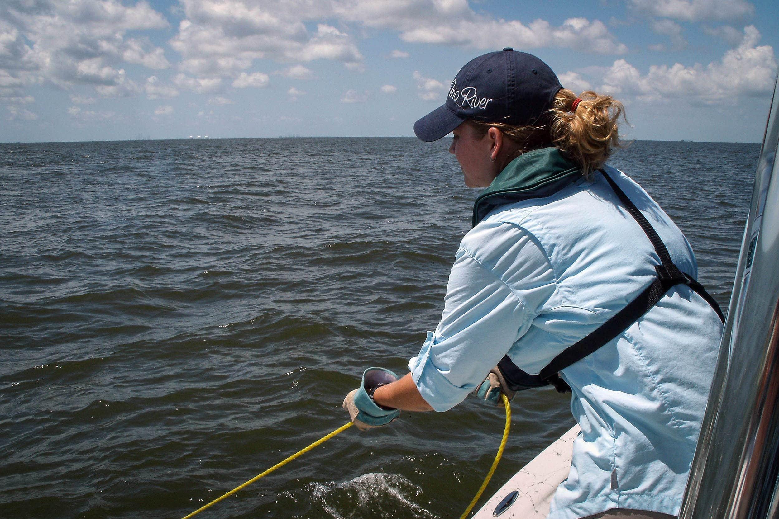 Kristen Vale pulls in a trawl net